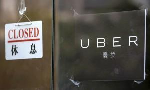 """Vụ Grab """"thôn tính"""" Uber Đông Nam Á: Khách hàng và tài xế hưởng lợi?"""