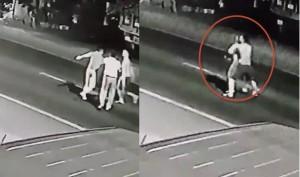 Nam thanh niên cởi trần bế bạn gái ra đường chờ ô tô tông để cùng chết gây phẫn nộ