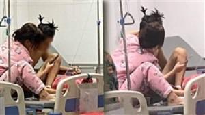 Hình ảnh cặp đôi trẻ trên giường bệnh khiến nữ điều dưỡng thực tập phải ghi lại rồi chia sẻ lên MXH